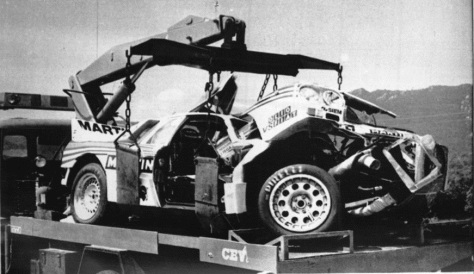 Bettega's Lancia 037 hoisted up after the crash
